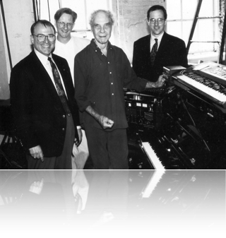 Merce with me and the guys from Yamaha. I got them to donate a Disklavier to anchor the electronic setup in the studio.