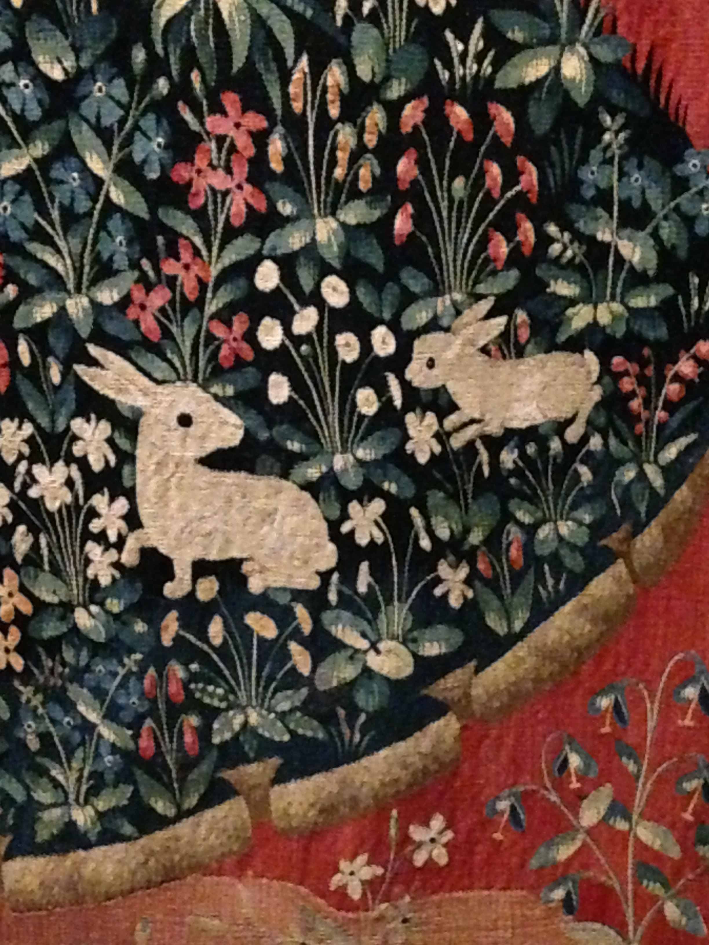 Beautiful little rabbits inhabiting the millefleurs gardens of The Lady and the Unicorn.