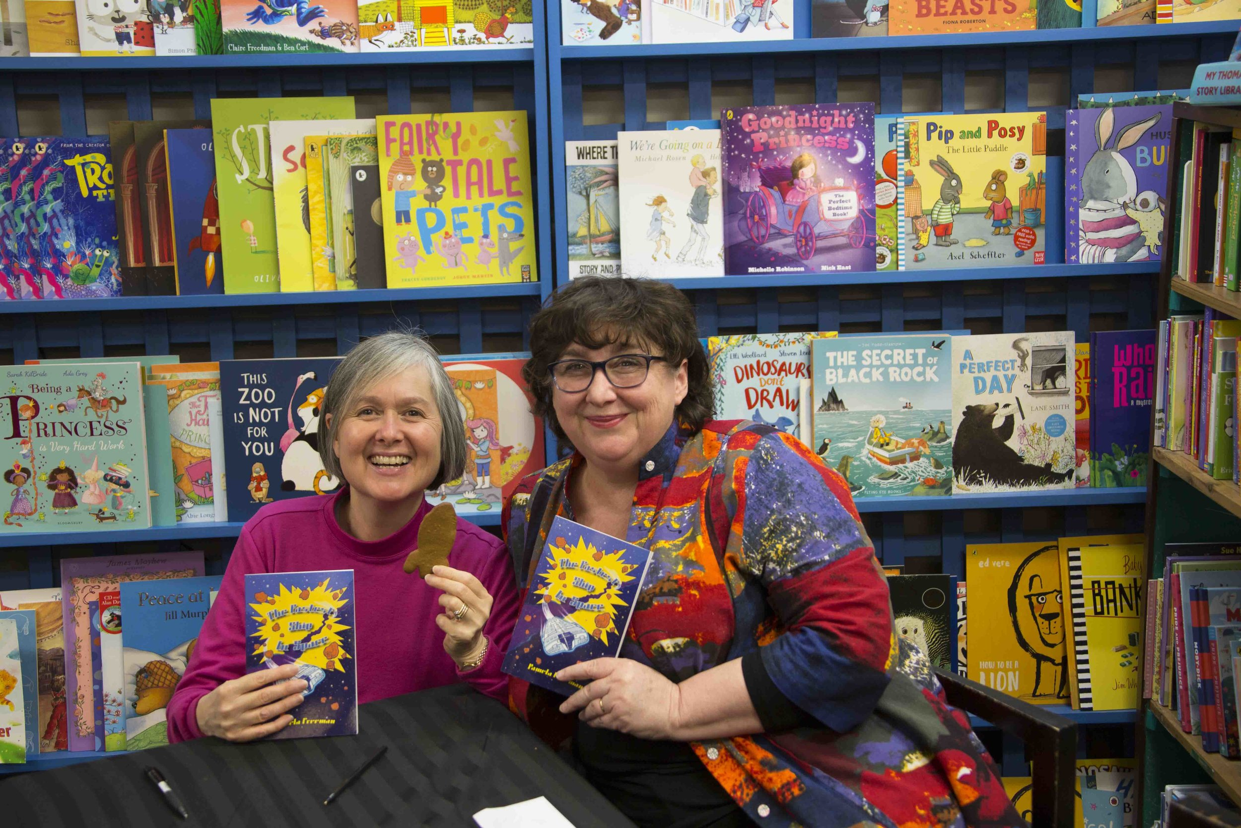 Yvonne Low (Illustrator) with Pamela Freeman (Author) and  The Fastest Ship in Space .  I'm holding a delicious space rocket biscuit which Pamela baked especially for the launch!
