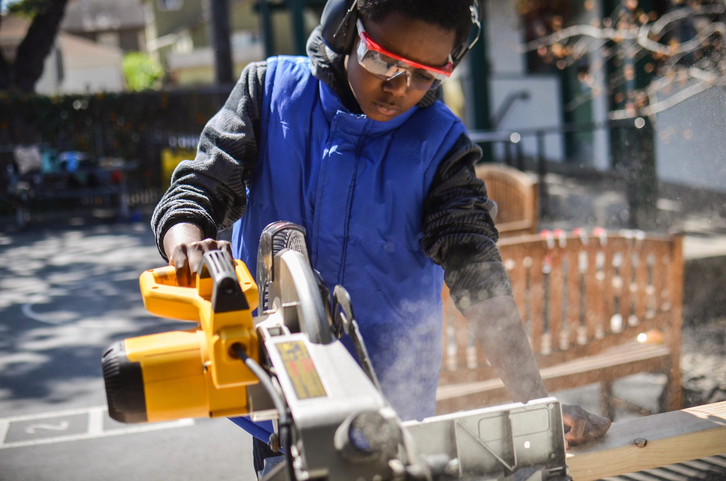 Taj makes another controlled and precise cut on the chop saw.