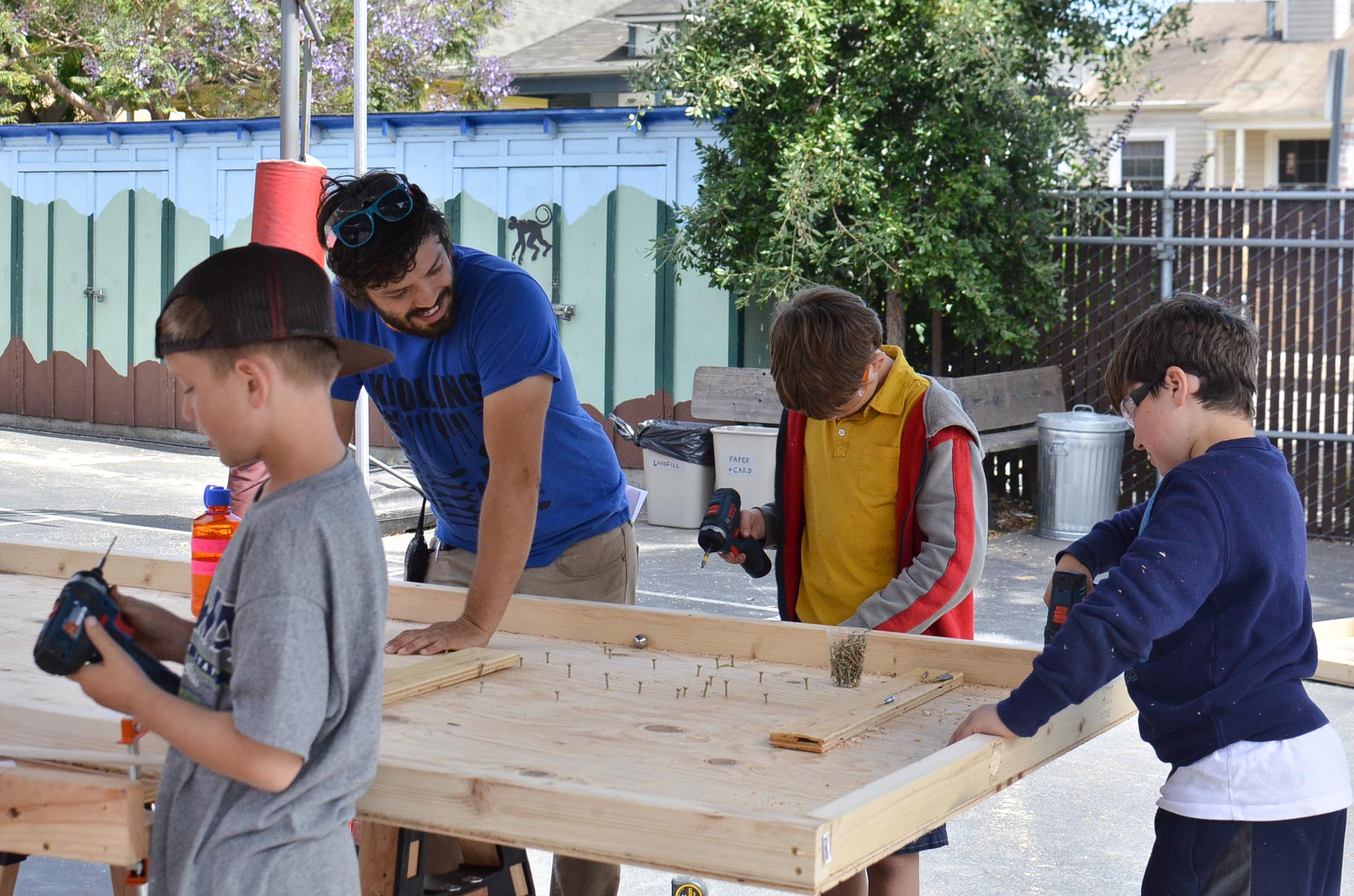 """Josh's team (now called the Ball Bearians) gets to work on their """"Plinko"""" board."""