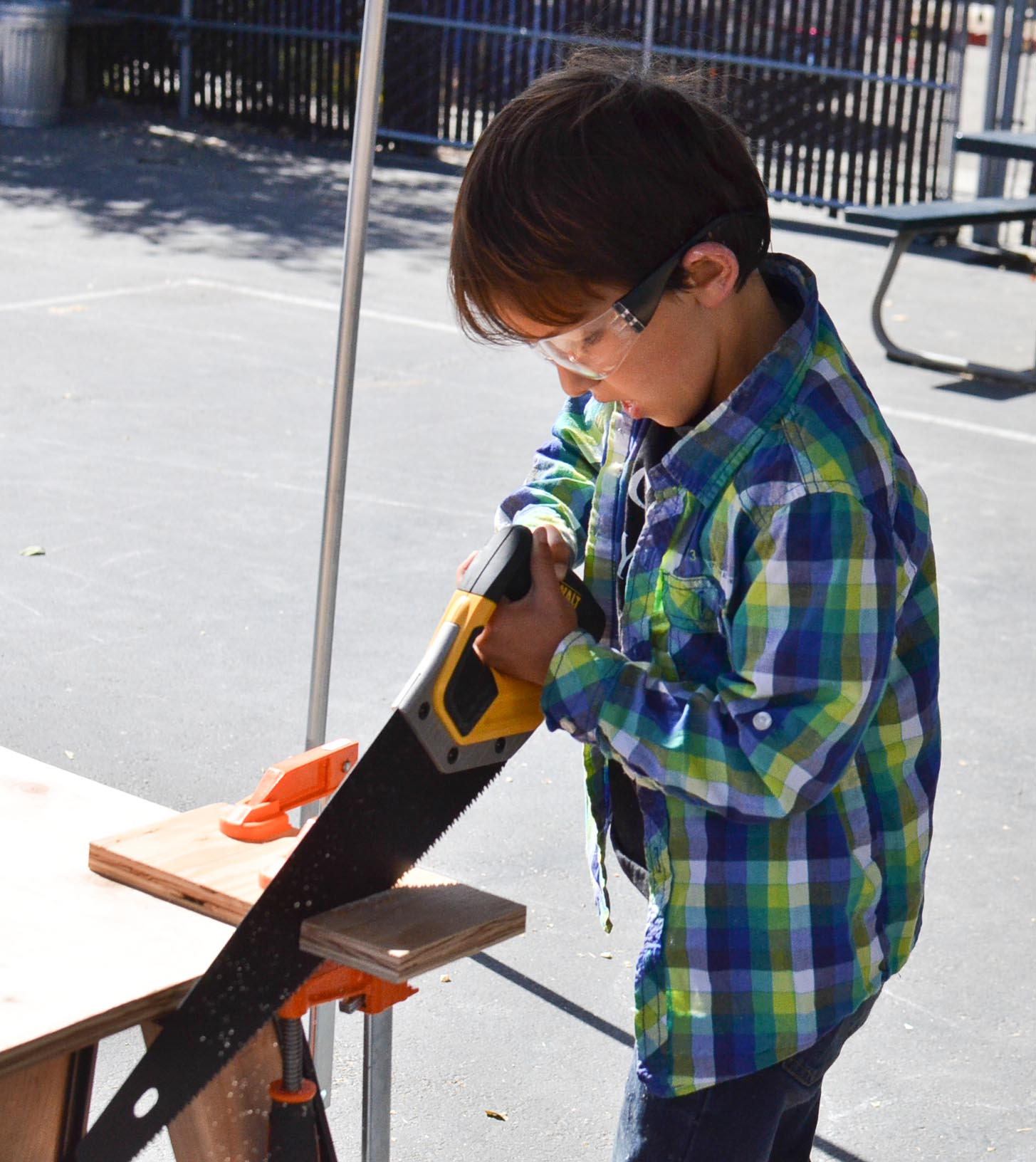 Griffin demonstrates great technique with the hand saw.
