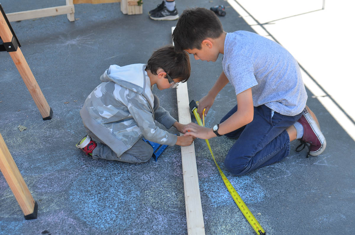 Ben and Griffin measuring and marking.