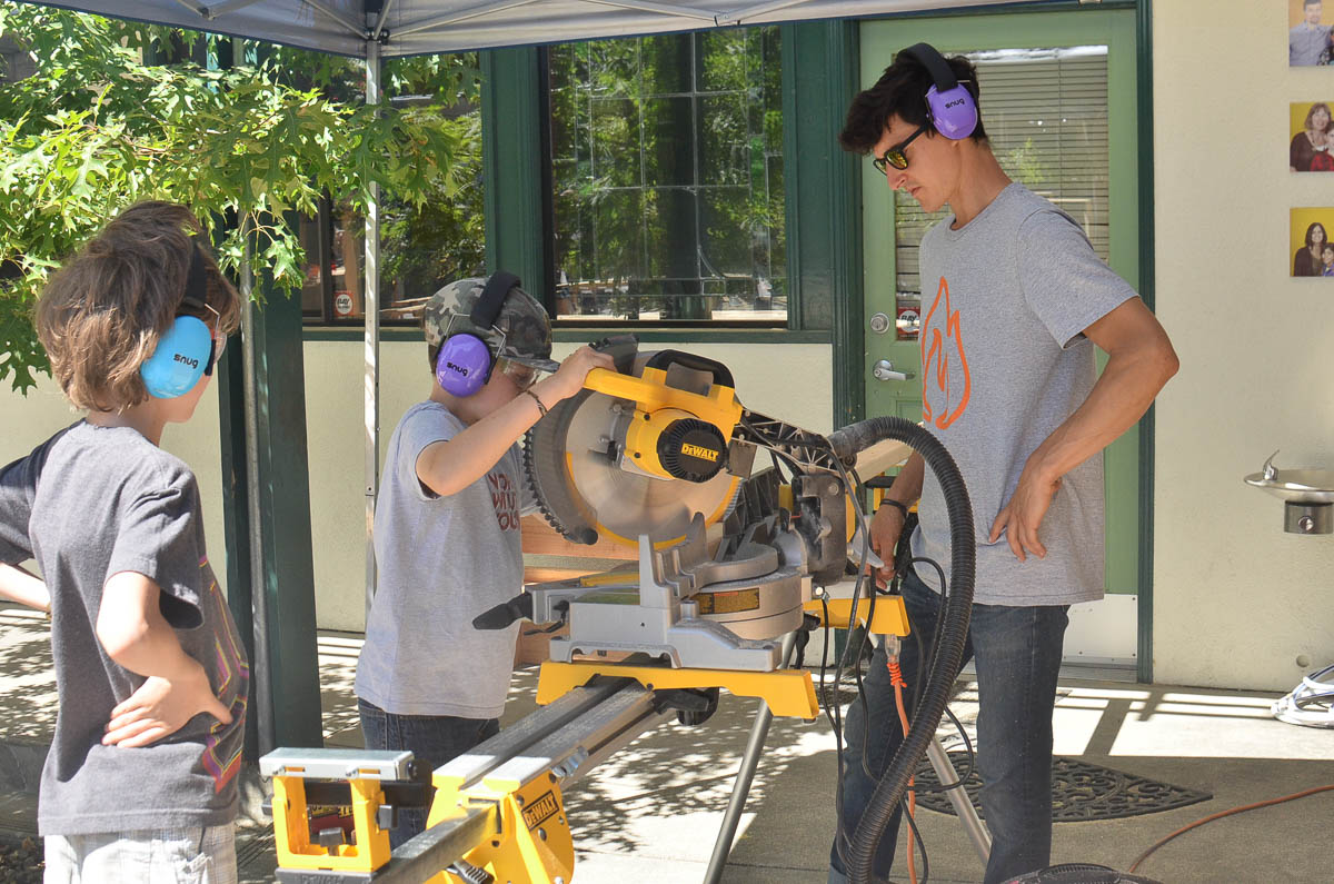 Cam and Rudy, our dynamic duo, on the miter saw (watched over by Ben).