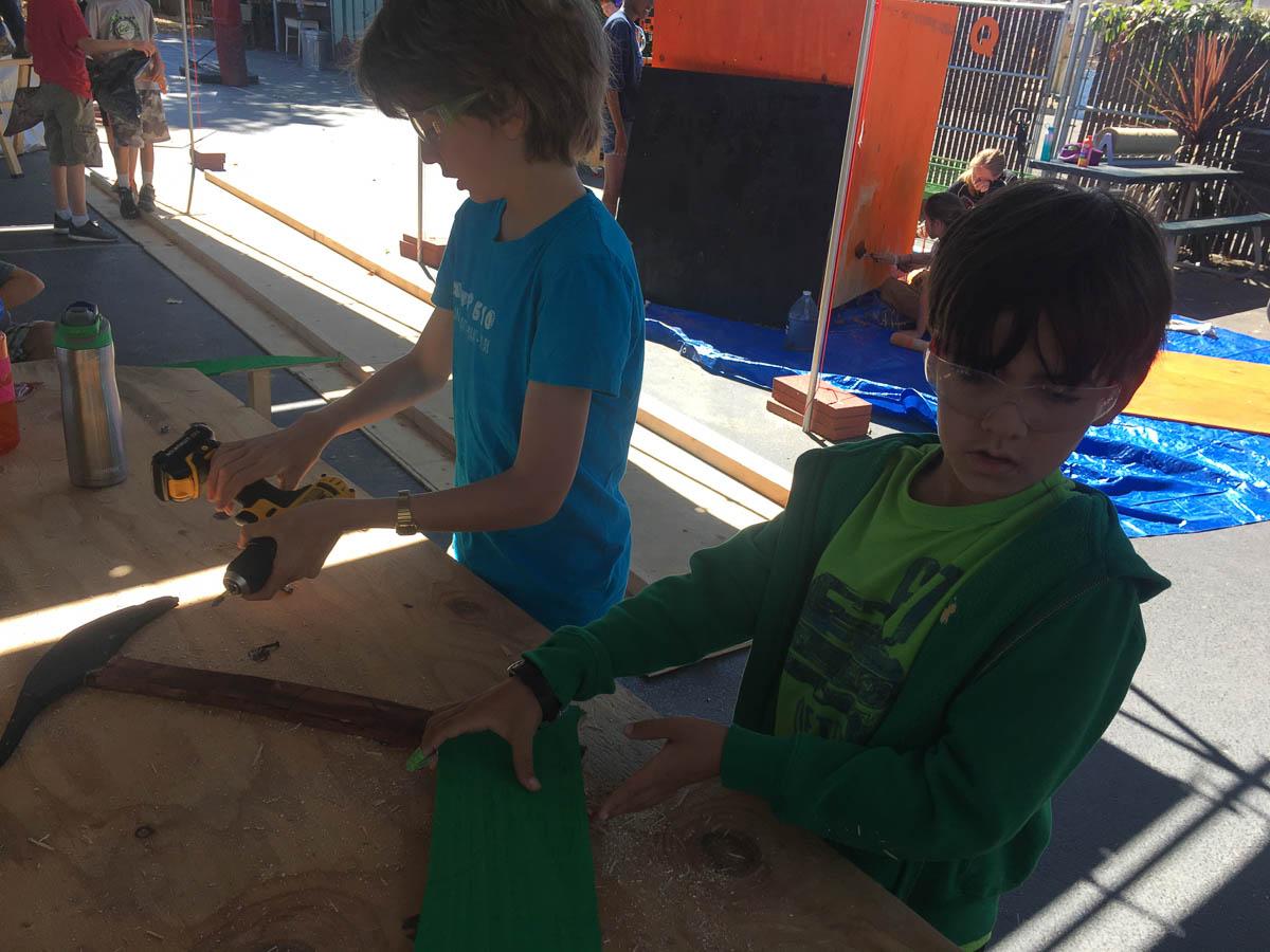 Robert and Cam make some final adjustments to the Mine-o-sauraus.