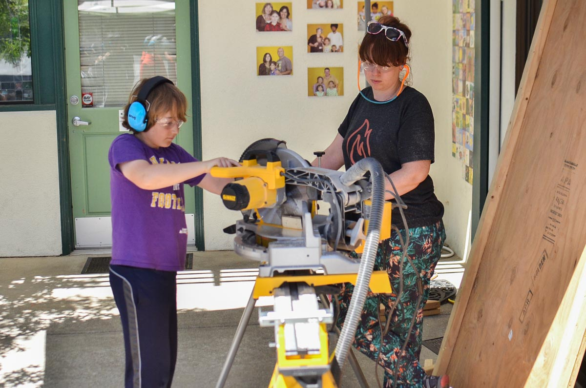 Tool training moved quickly so Jenny had time to introduce Asa to the 45 degree miter cut.