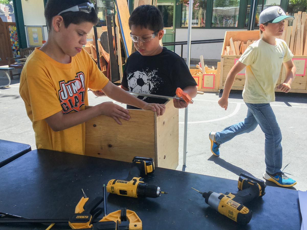 Hector and Alex put together a box to share their design with team Squeeze.