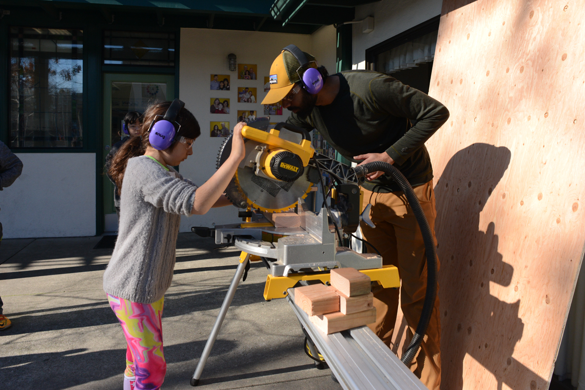 Lenka makes her first miter saw cut of the day.