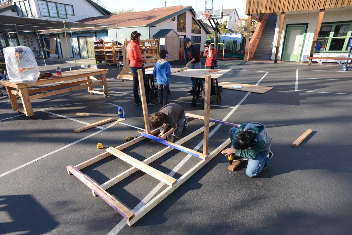 The truck frame comes together quickly with teamwork.
