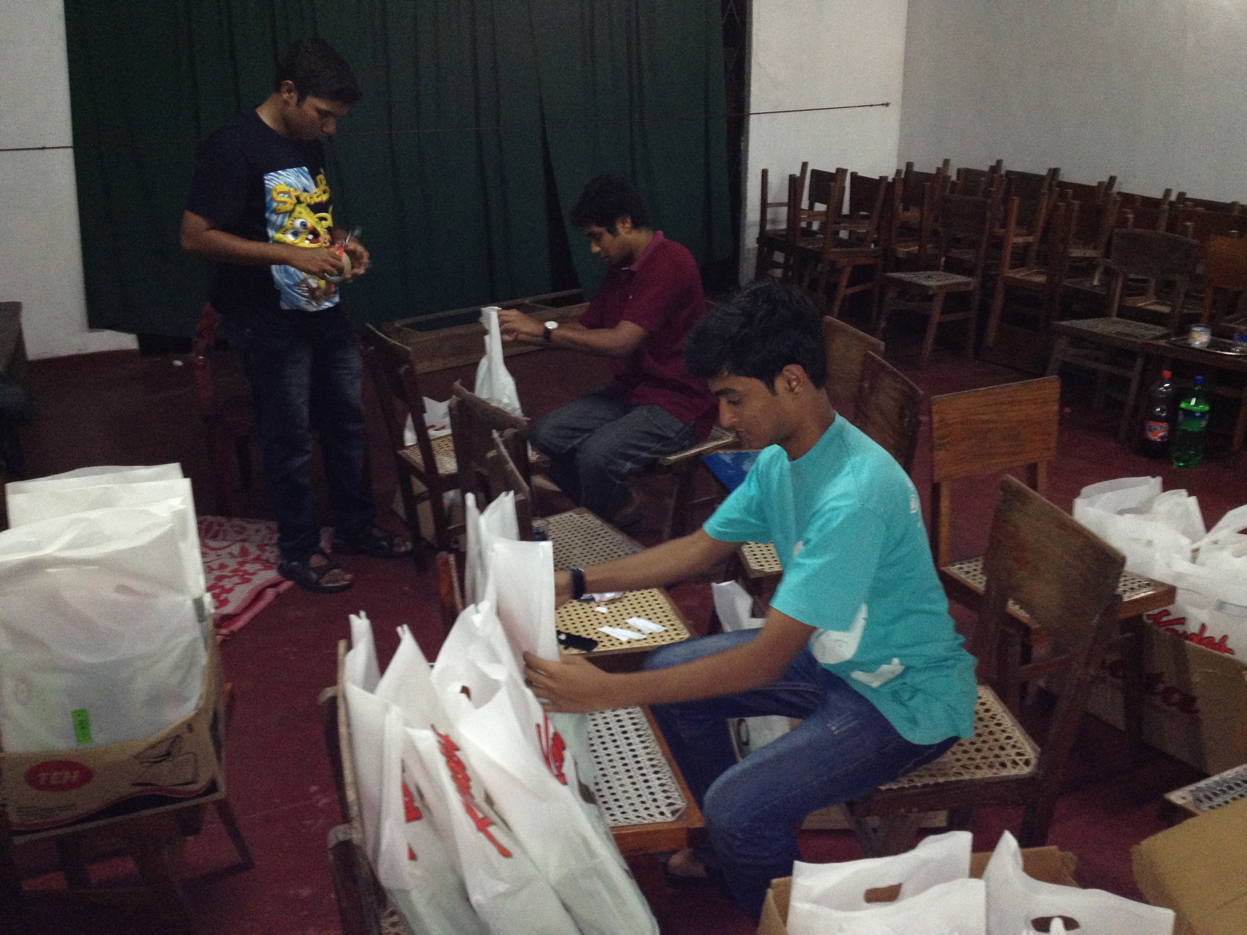 Volunteers putting the book packages together for the children