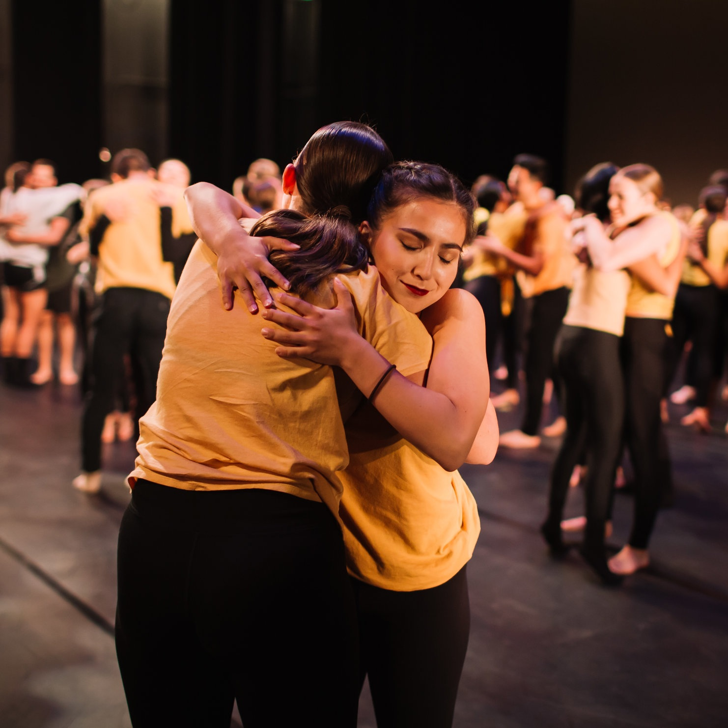 2018 Participants hugging on stage before the performance. Photo © Emily Duncan