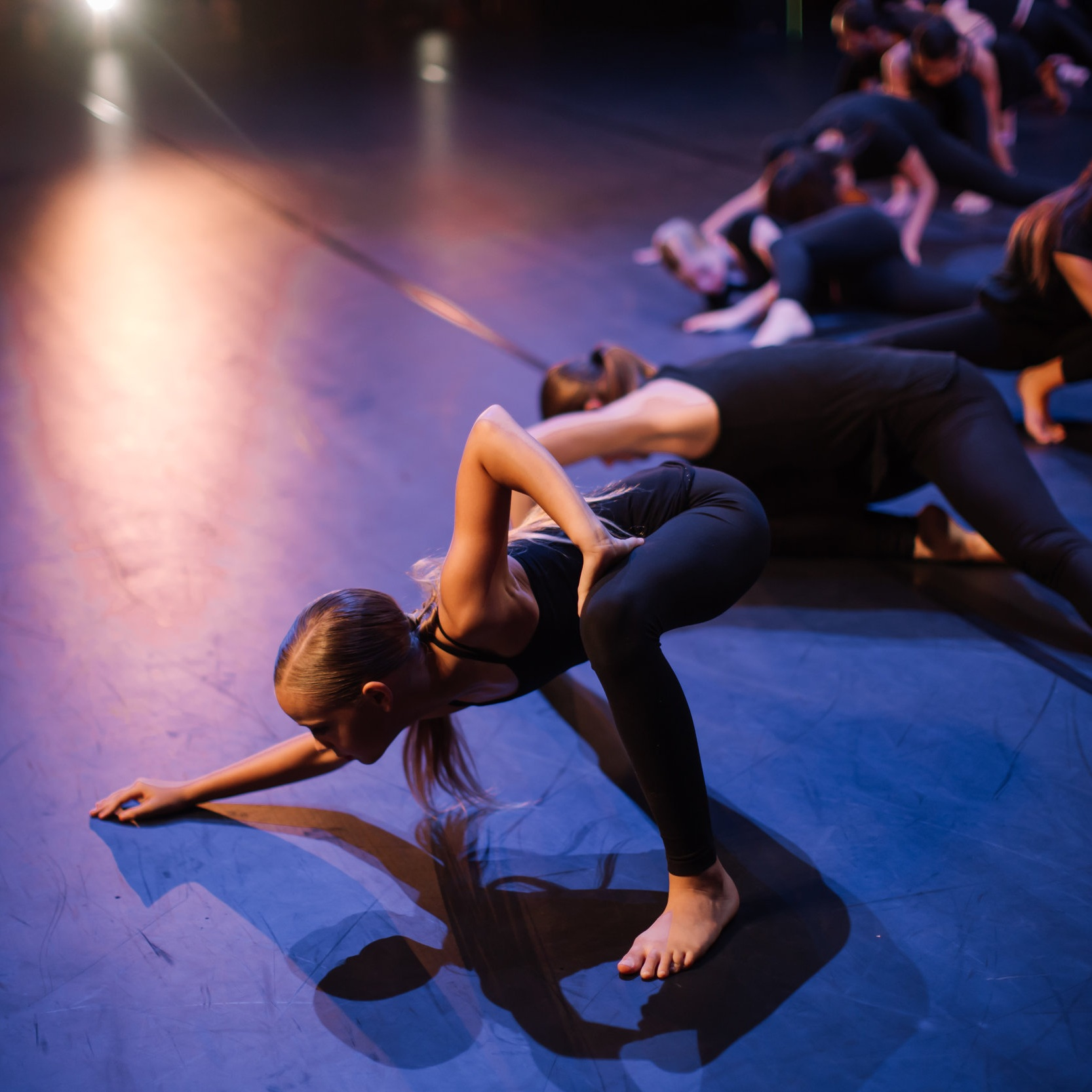 Teen Division dancers performing together on stage. Photo © Emily Duncan