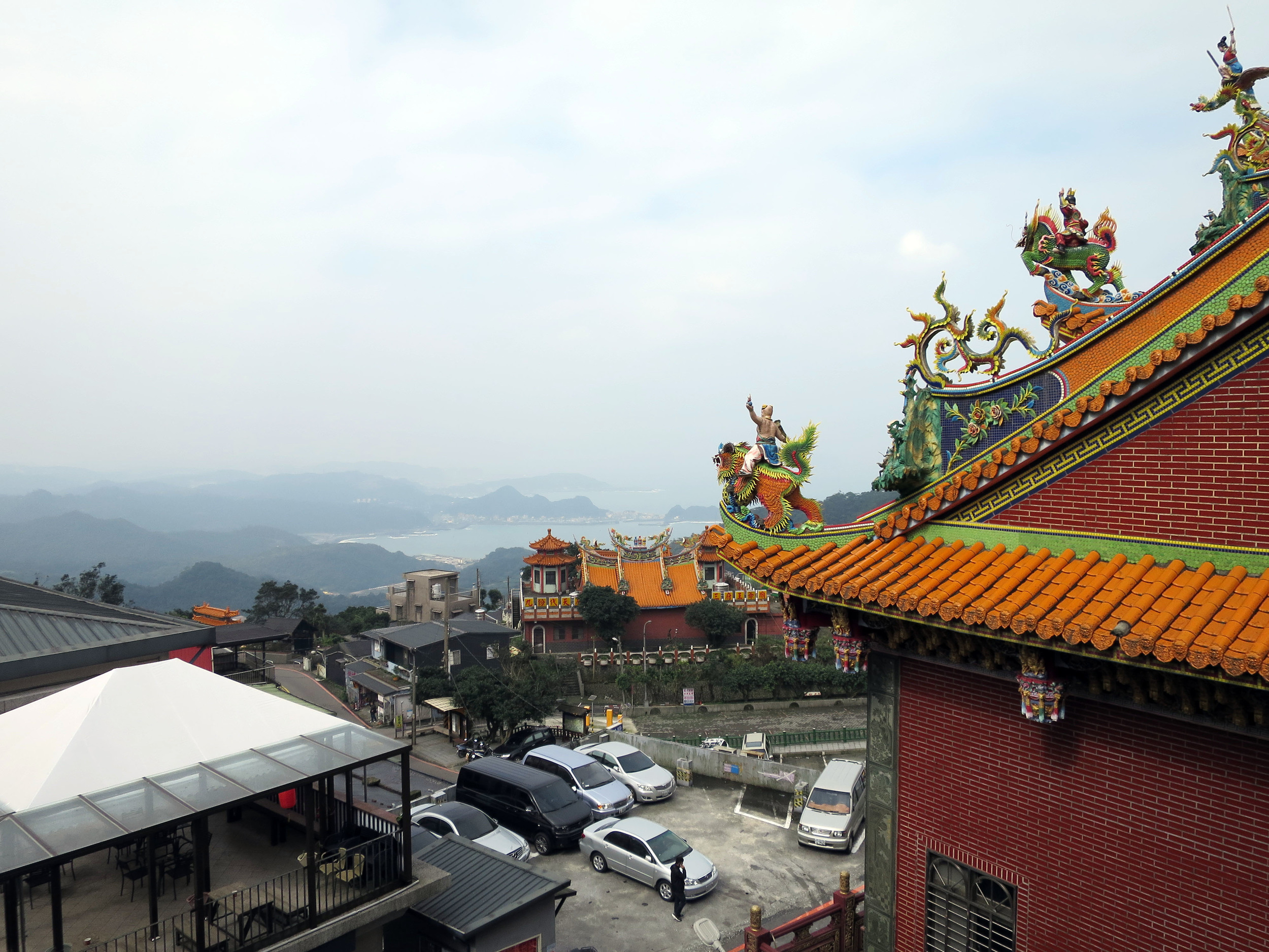 View from Jiufen bus stop. Temple roofs and the Pacific Ocean in Taiwan.