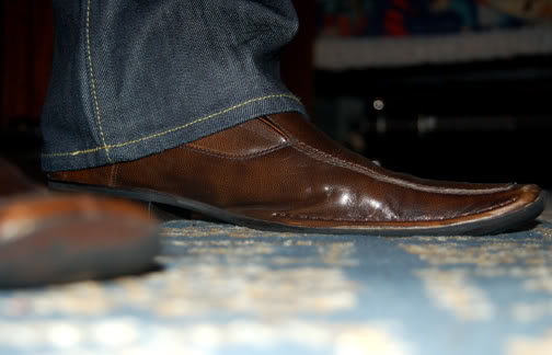 the colors are a good match but the opening of the jeans are too wide for such a sleek pair of slip on leather shoe