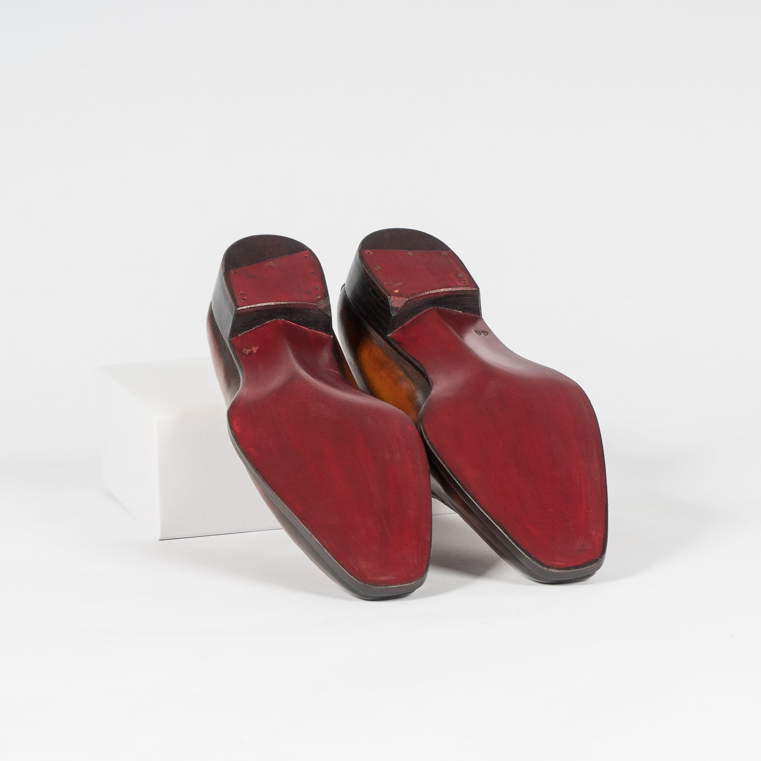UNO close channel bevel waist outsole in a hand painted dark maroon color.