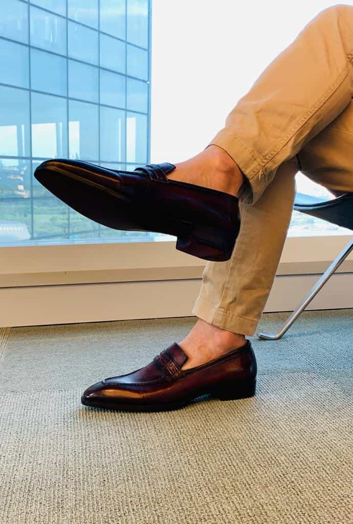 a close up look on the chinos and loafer combination