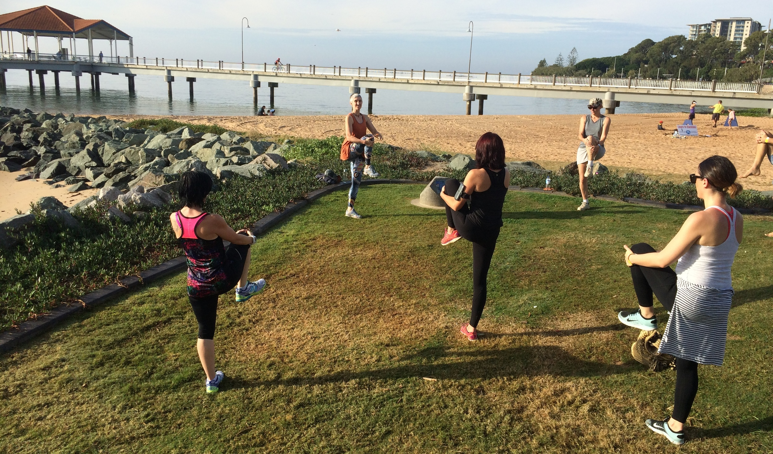 Another wave of runners cooling down with the slacklining in the background