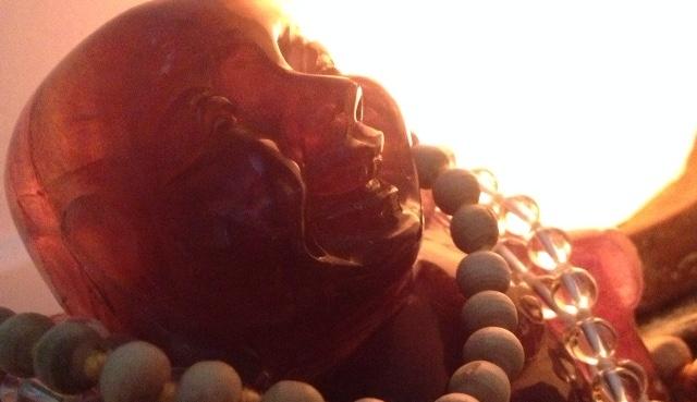 Fluorite Buddha with mala beads