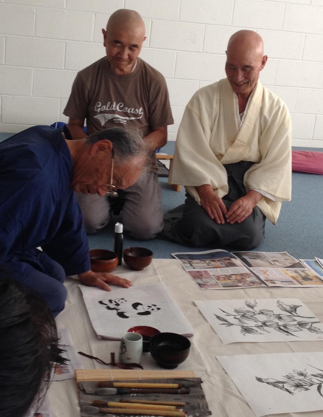Sumie workshop with Kawaku-san teaching us while Teshin-san (L) and Jinen-san (R) look on.