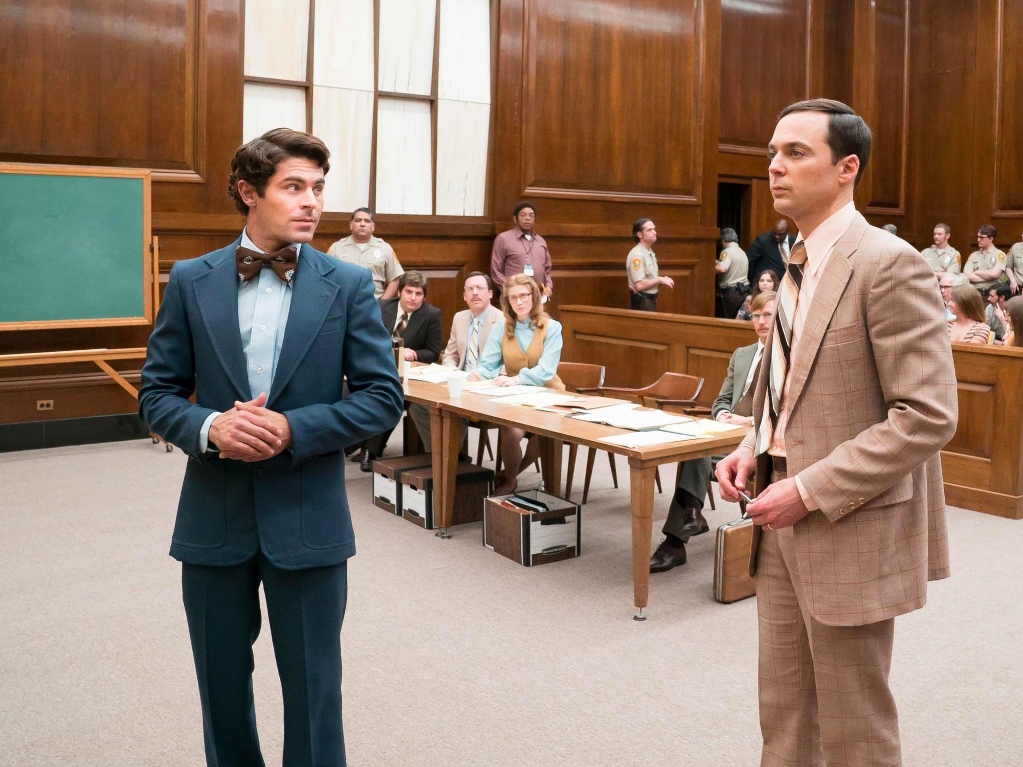 From left to right: Zac Efron as the infamous serial killer Ted Bundy and Jim Parsons as Floridian prosecution lawyer Larry Simpson in  Extremely Wicked, Shockingly Evil, and Vile .