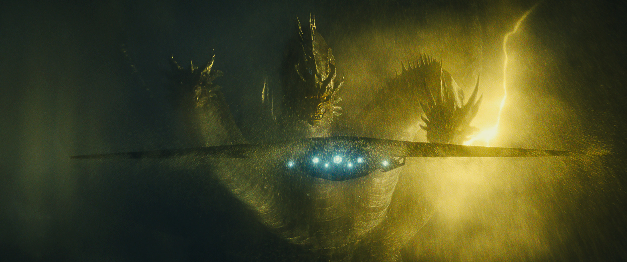 The terrifying three-headed King Ghidorah in  Godzilla: King of the Monsters .
