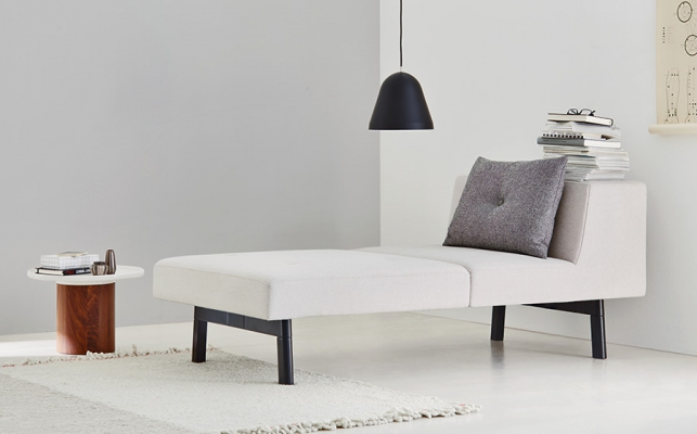 Taking the weight off your feet in style with black frame and legs and white leather upholstery