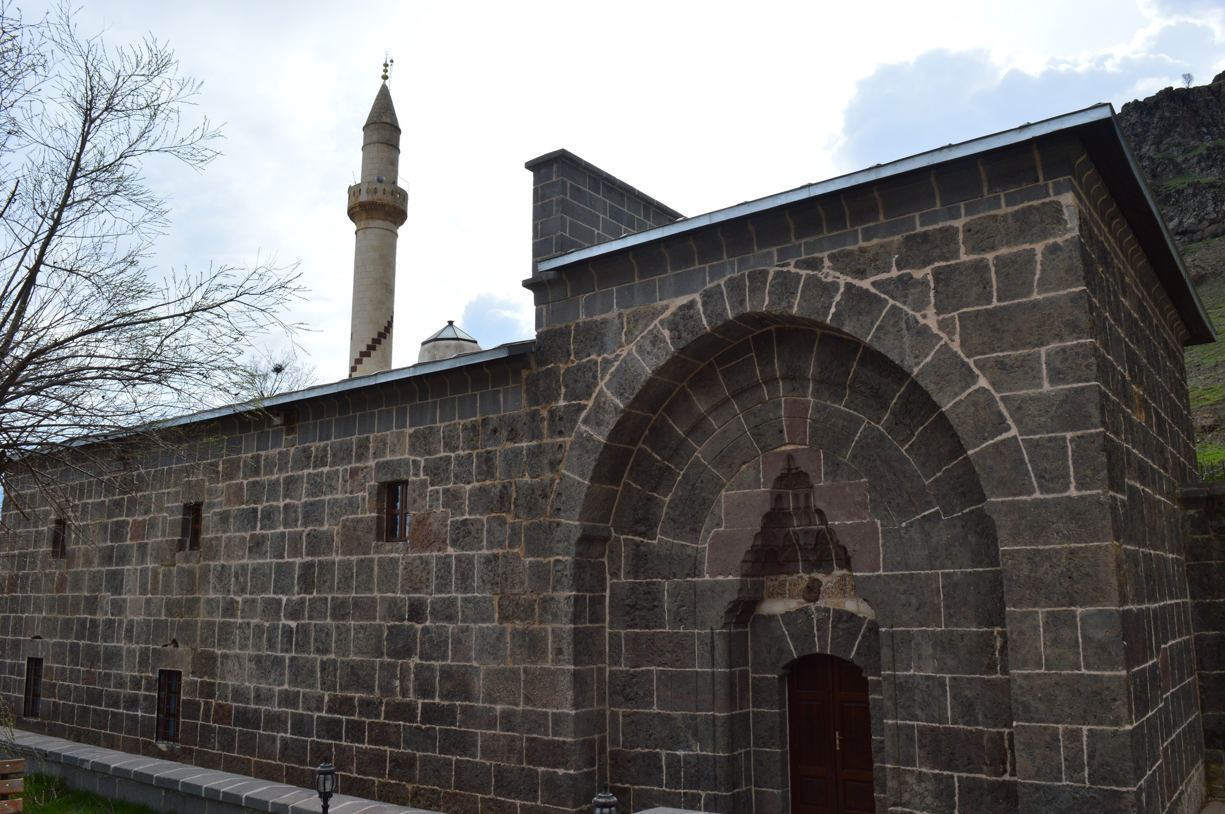 Mazgirt's only mosque. Look at the ground floor windows - the stones do not fit onto each other, leaving gaps.