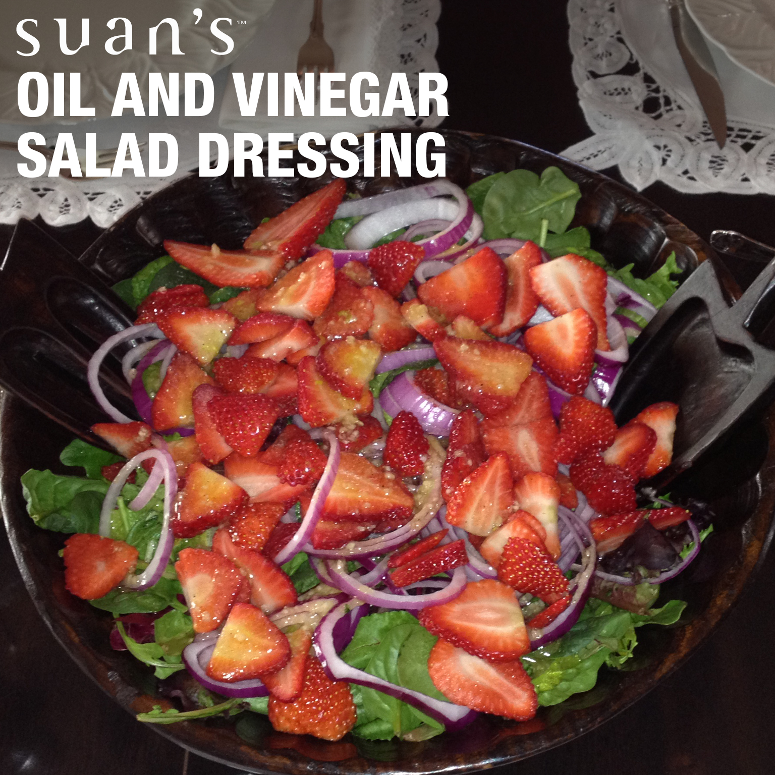 Photo includes mixed greens, red onions and fresh strawberries with Suan's  ®   Oil and Vinegar Dressing