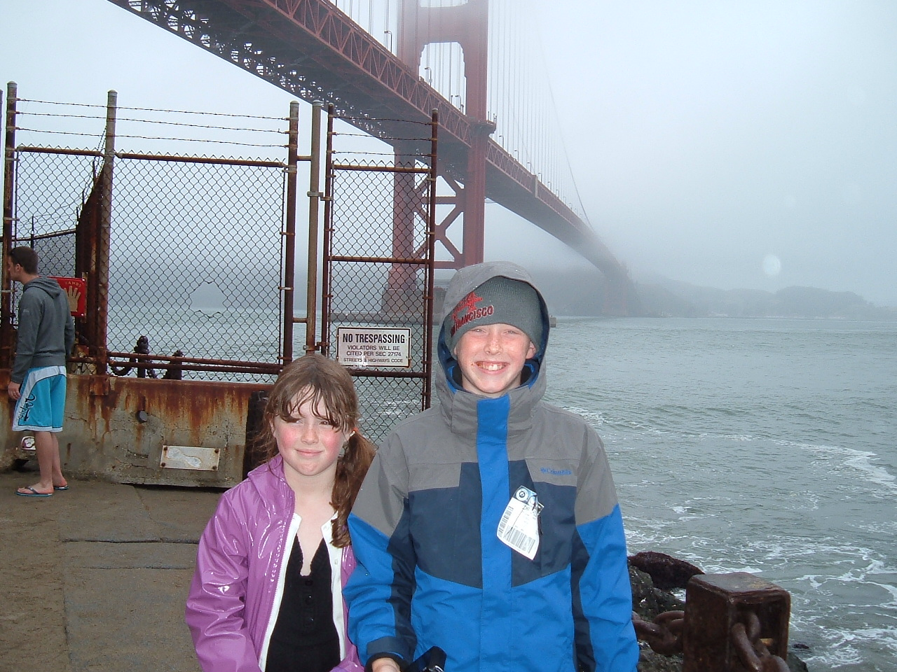 Golden Gate Bridge during a rainy June. Such sincerity in those smiles...
