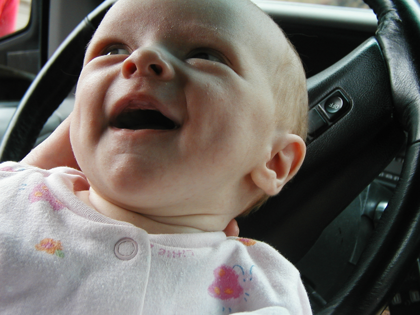 This was Audrey's first-ever legit smile. SEE WHAT A GOOD MOM I WAS...NURSING IN THE DRIVER's SEAT. RELAX - I'm sure the car was in park.