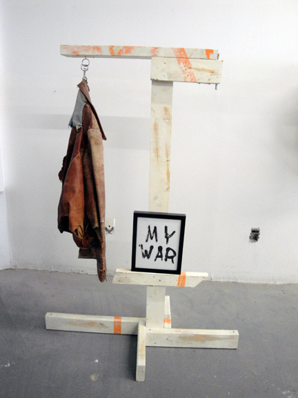 Jesse Butcher, Season Of The Witch , 2013. Wood, latex paint, aerosol paint, polyurethane, framed mono-print, leather jacket, hardware. 38 x 28.5 x 54 inches