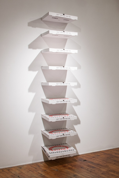 Alan and Michael Fleming,  Pizza Boxes (Stack)  , 2013. Cardboard pizza boxes and metal brackets. 18 x 76 x 18 inches