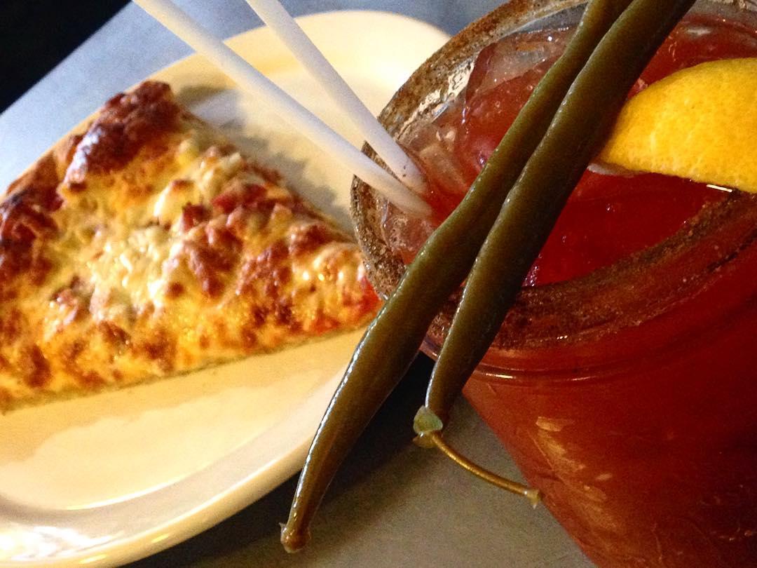 Brickyard pizza slice and drink.jpg