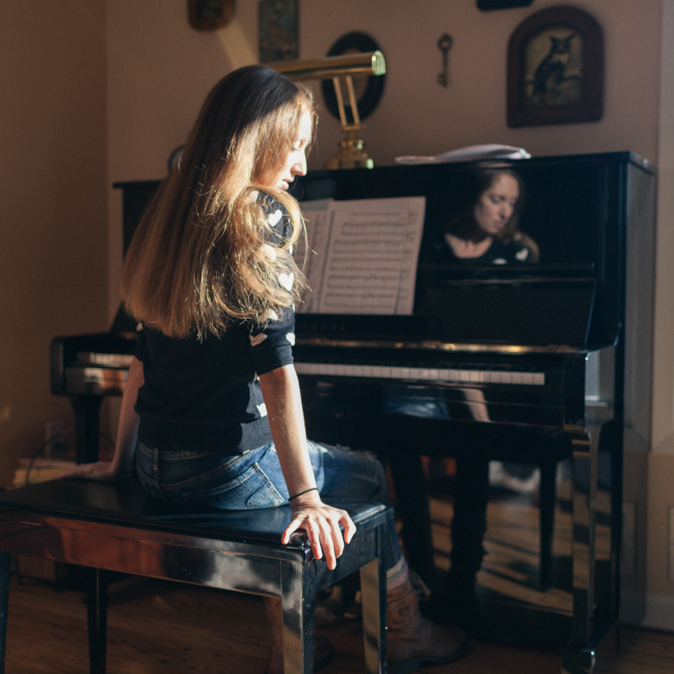 The year is 2014 and I was newly exploring self-portraiture. That reflection you see in the piano? Everyone loved that. It was sheer luck and completely unplanned. I had no idea of what I was doing. I had no vision for this self-portrait. I just knew that I liked to play the piano and I liked photography.