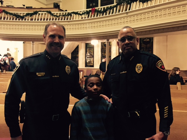Normal Police Chief Rick Bleichner and Bloomington Chief Brendan Heffner with a young participant in Thursday's Breaking Barriers forum.
