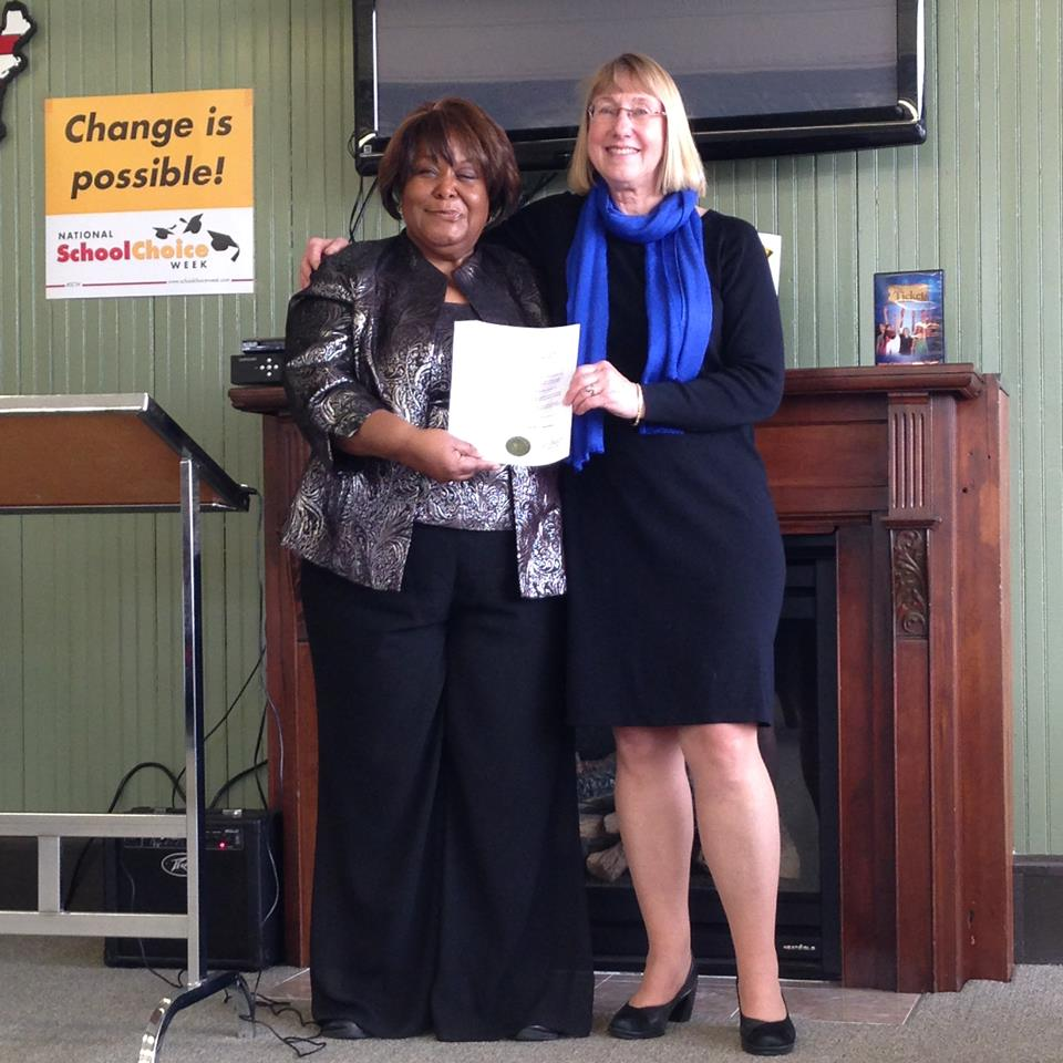 Bloomington Alderman Karen Schmidt celebrates National School Choice Week at God's Deliverance Outreach Ministry with Pastor Rochelle Patterson.