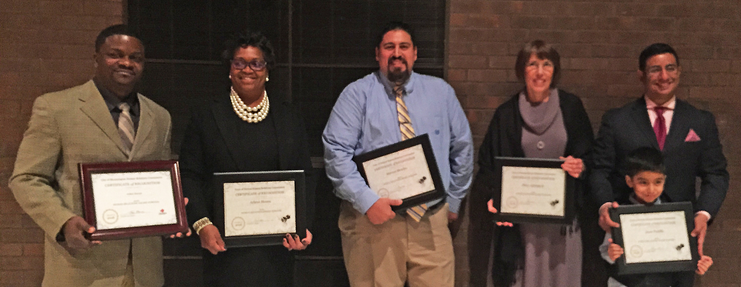 Arthur Haynes, left, and Marcos Mendez, center, with other MLK Human Relations nominees, from left, Arlene Hosea, Not In Our Town: Bloomington/Normal's Mary Aplington, and Jesse Padilla.