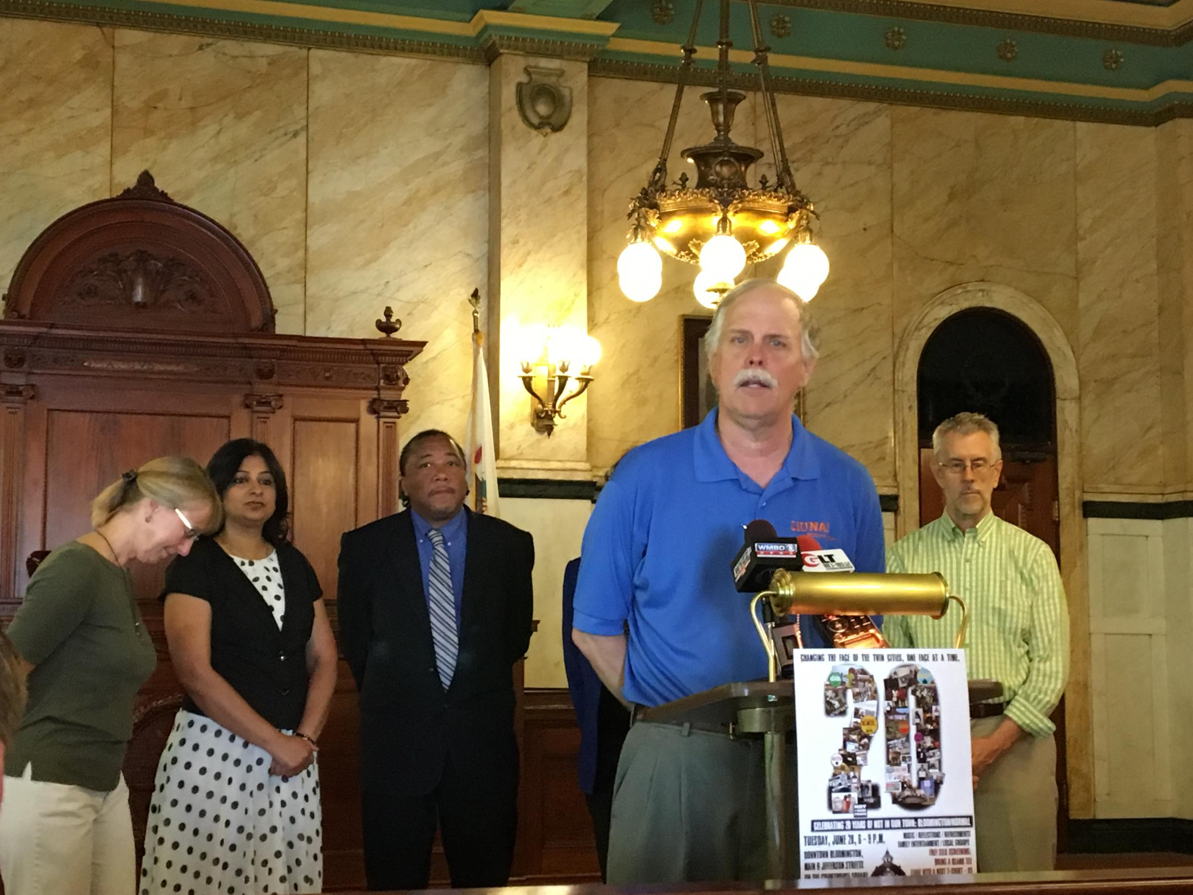 NIOTBN charter member Mike Matejka leads a news conference announcing the organization's 20th anniversary celebration June 28 on the Old Courthouse square in downtown Bloomington. (WJBC)