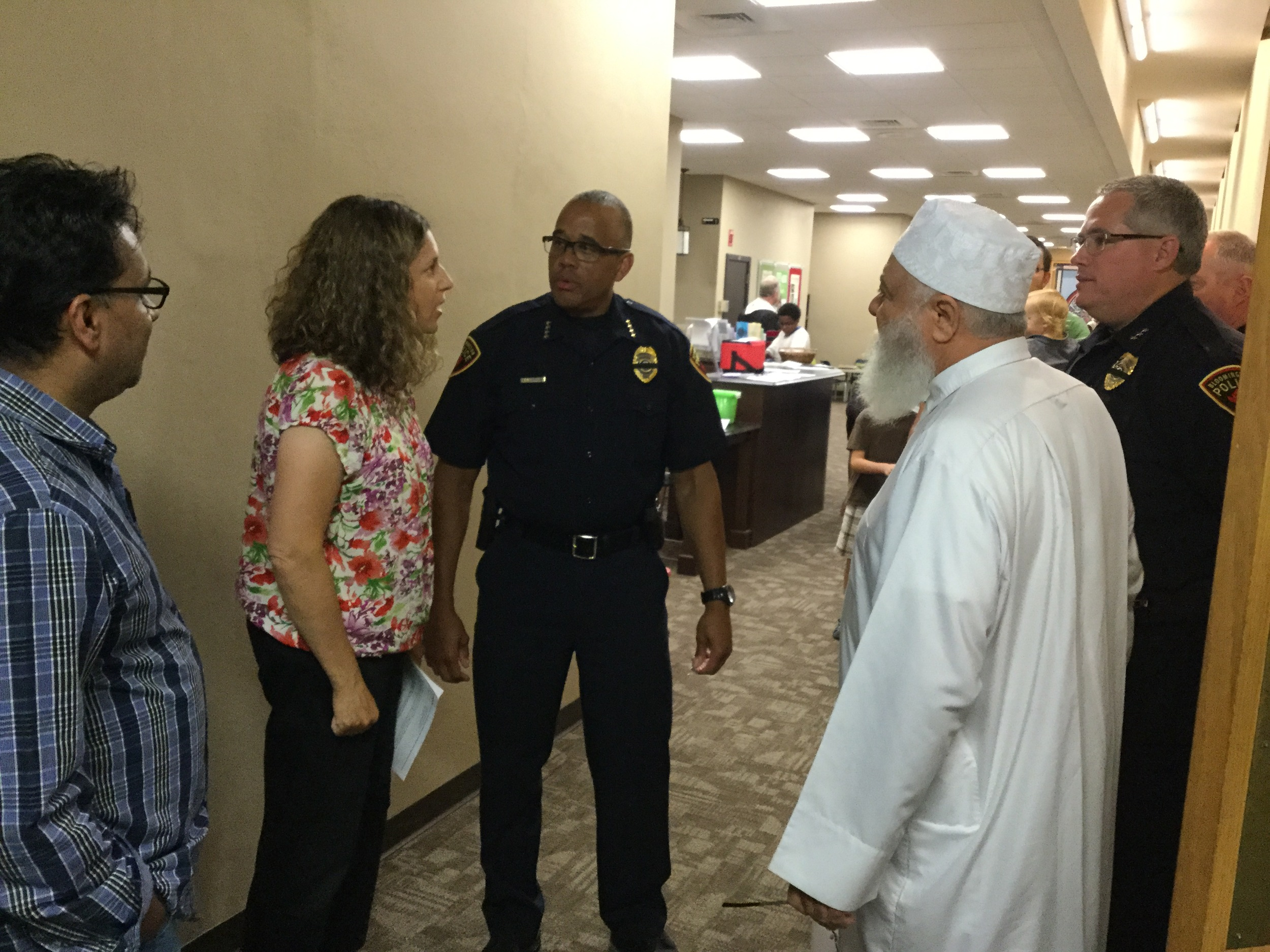 Moses Montefiore Rabbi Rebecca Dubowe and Imam Abu Emad AL-Talla chat with Bloomington Police Chief Brendan Heffner prior to the vigil.