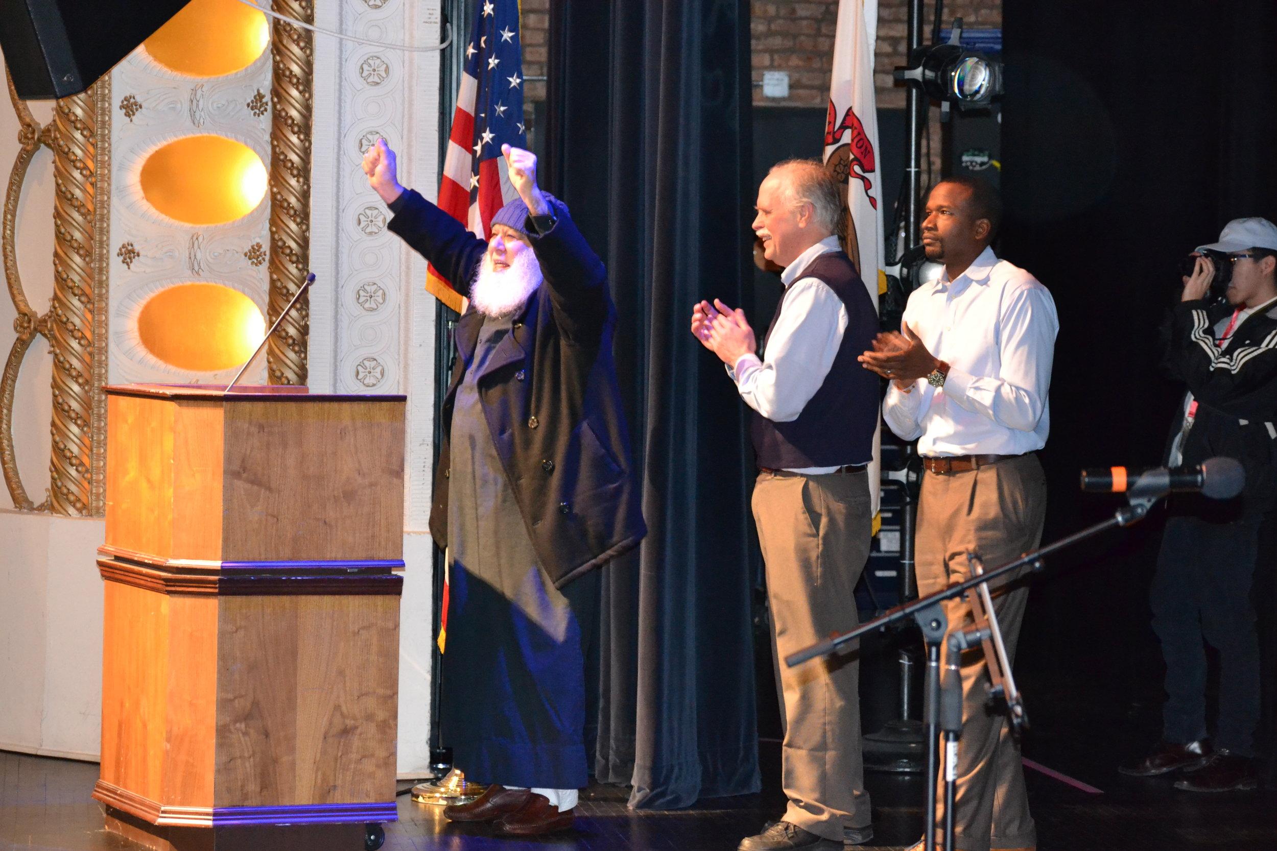Bloomington's Imam Abu-Emad Al-Talla, with NIOTBN's Mike Matejka and Dontae Latson.