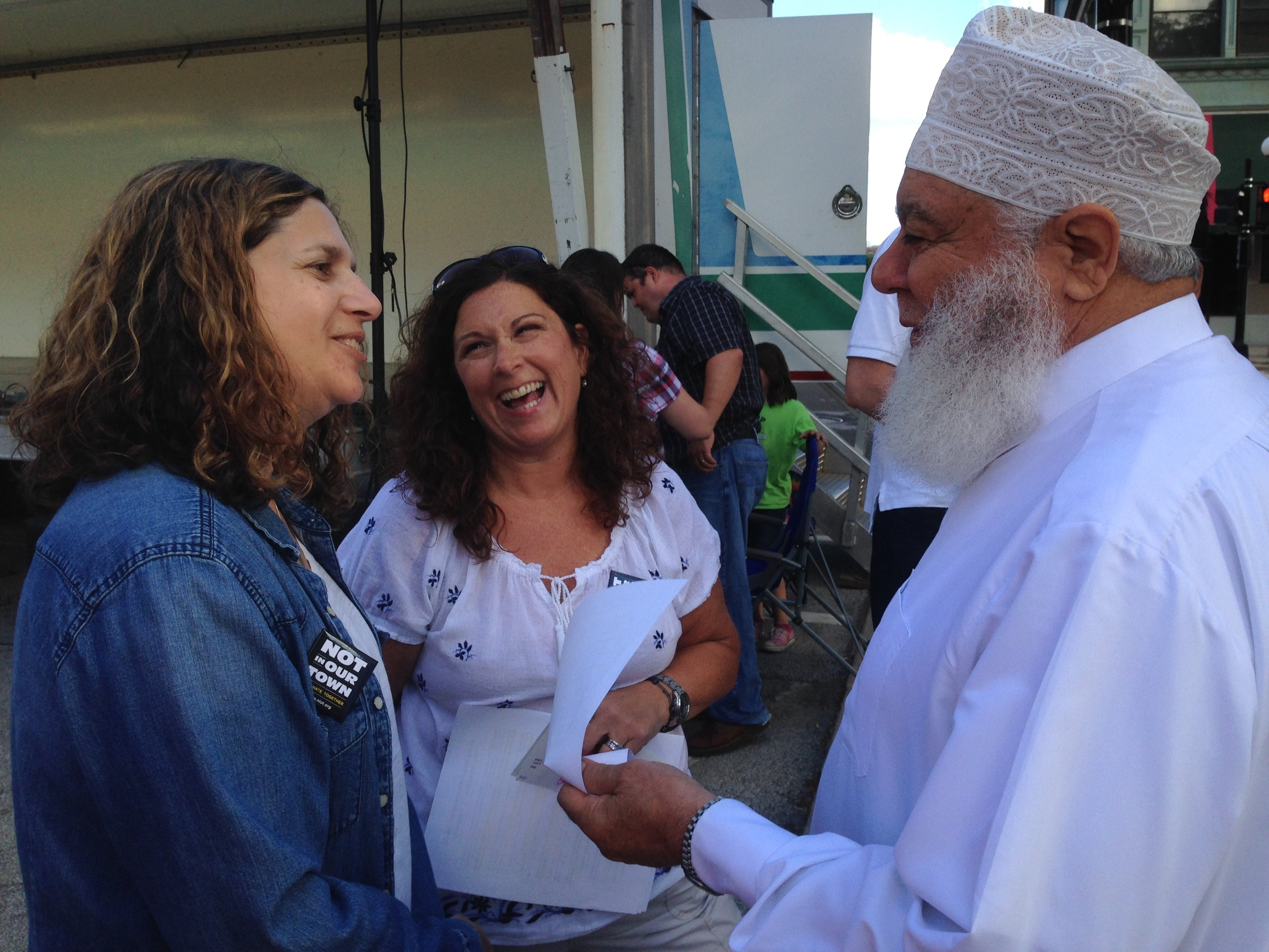 Shaikh Imam Abu-Emad Al-Talla chats with Rabbi Rebecca Dubowe, left, and former First Christian Church Associate Minister Kelley Becker during last summer's Not In Our Town: Bloomington-Normal 20th Anniversary.