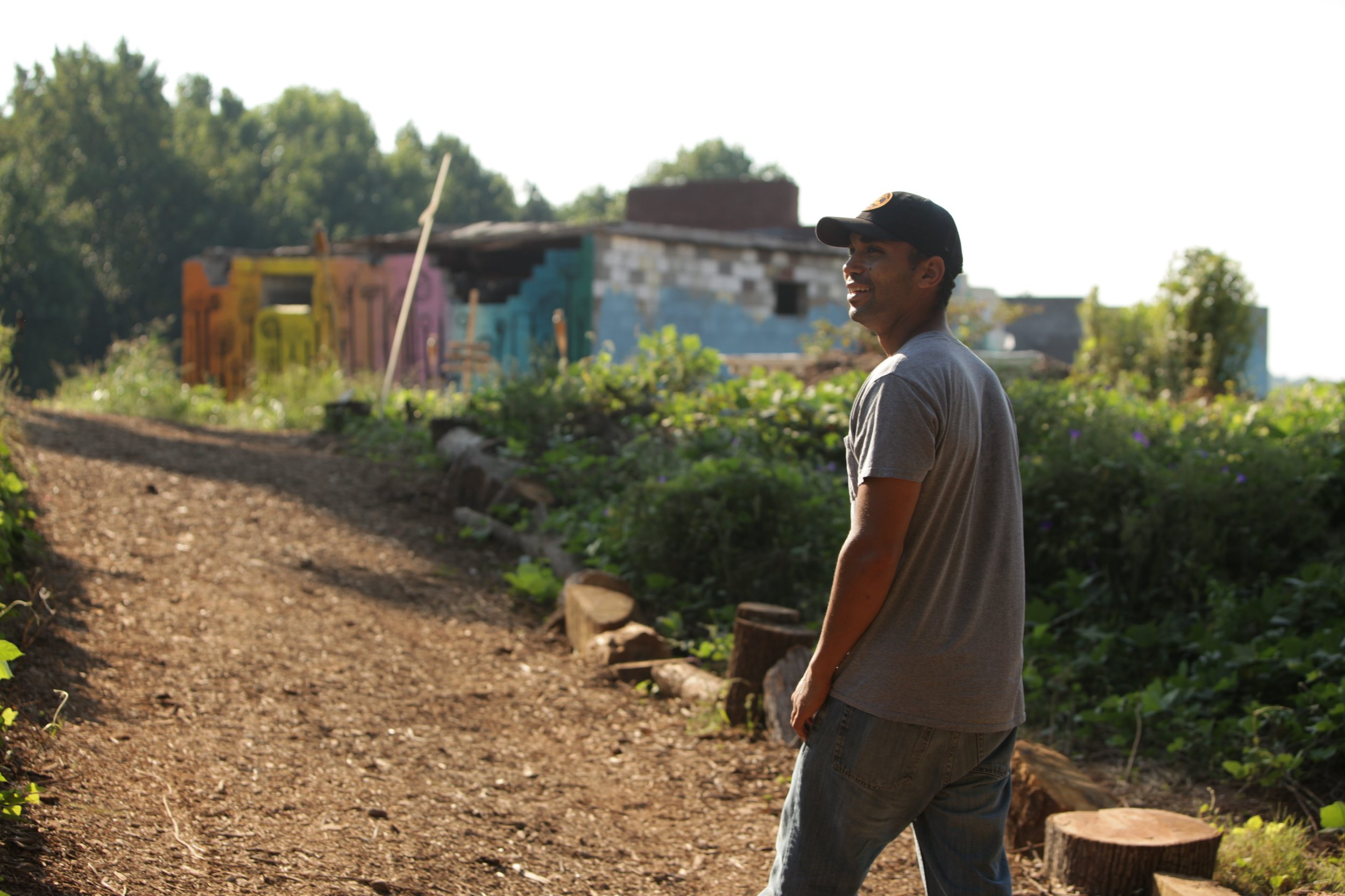 Nuri Icgoren, owner and urban farmer at Urban Sprout Farms, is pictured walking through the site of his Lakewood Heights farm.