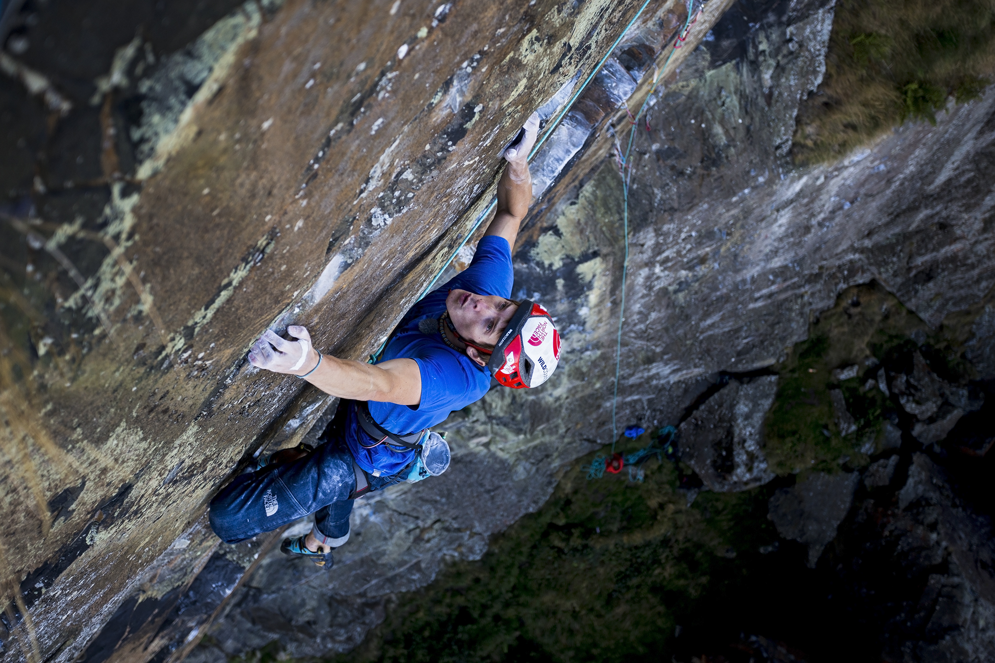 James Pearson at the start of crux of Rhapsody (E11) at Dumbarton. Image: Chris Prescott/ Hot Aches Productions