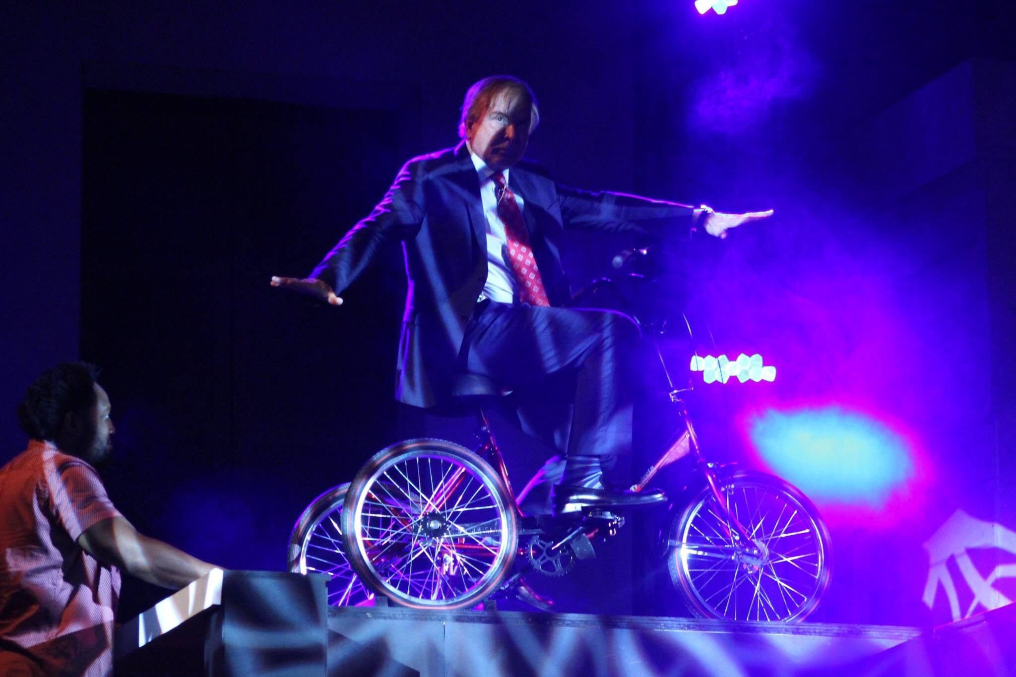 Pastor Steve Munsey rides tricycle