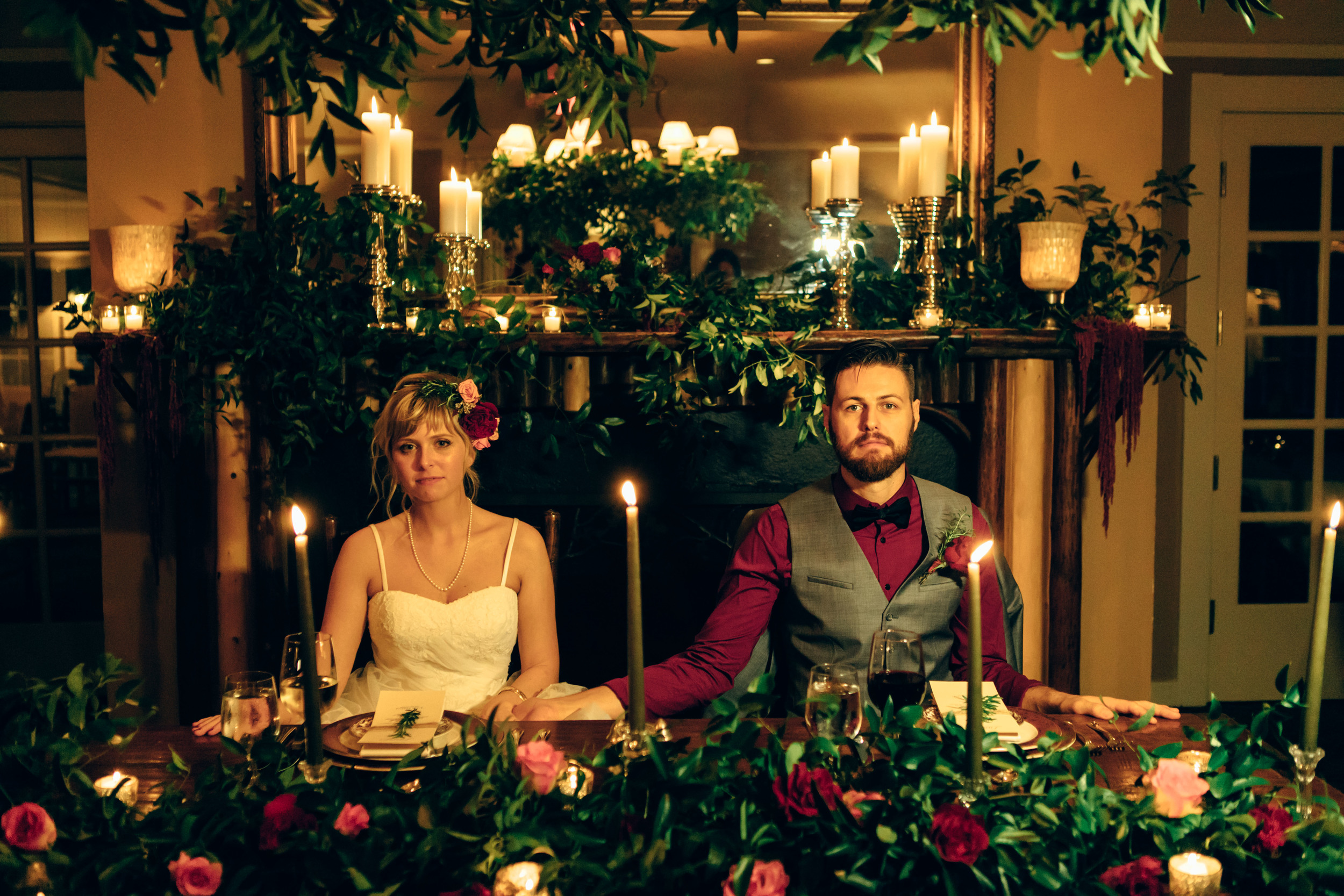 The candle-lit reception felt like mealtime in the Godfather. The couple happily obliged to a serious photo at the table.