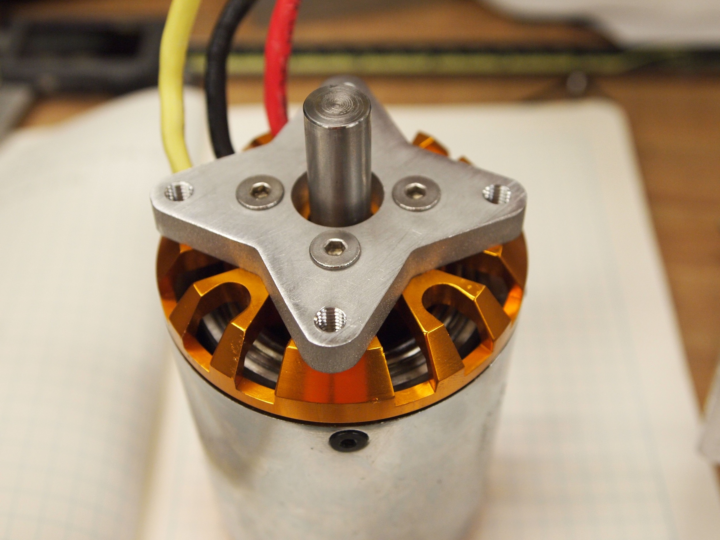 The motor mount attached to the motor. This is a large brushless motor which would typically be used to drive a propeller.