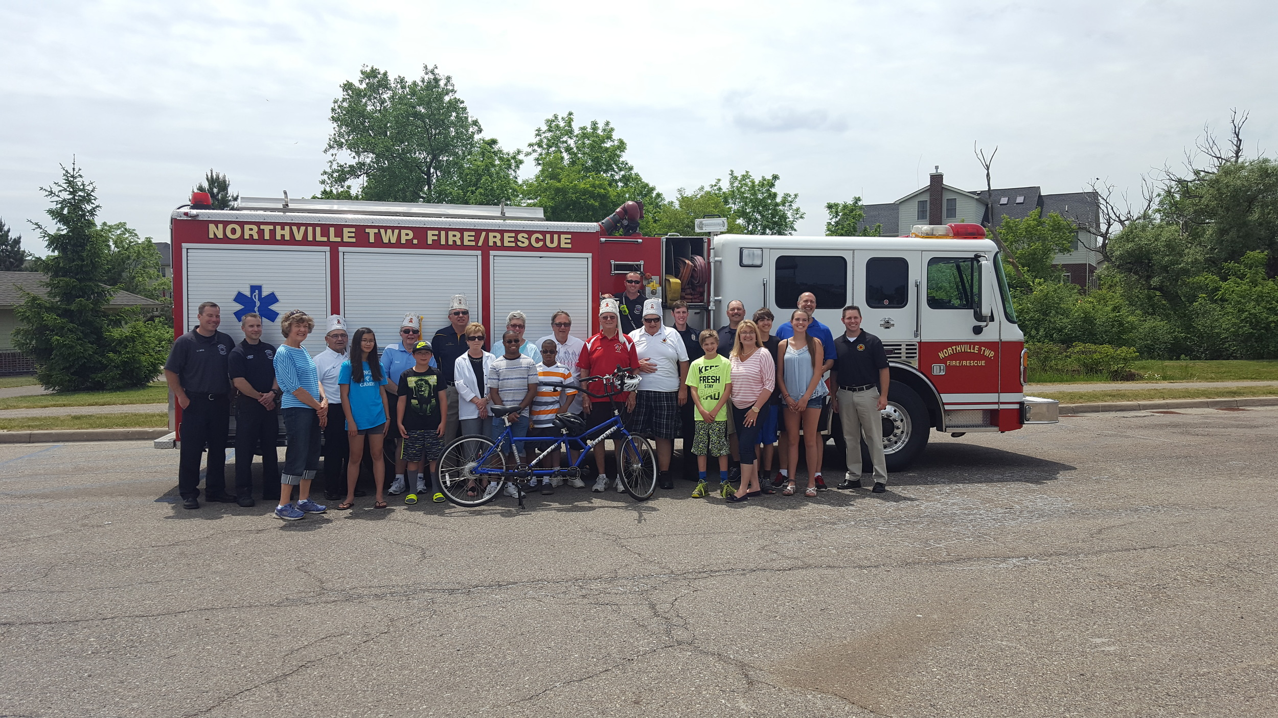 """We were excited to take part in the donation of a special needs """"Buddy"""" bike for a local family. Not only did we make a donation, but we were lucky enough to be part of the big reveal at Millennium Park. We hope you enjoy your bike Ben!"""