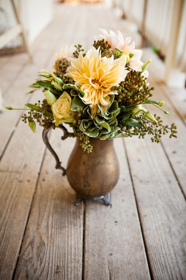 Source  - Consider the base, focal, and filler when arranging your flowers