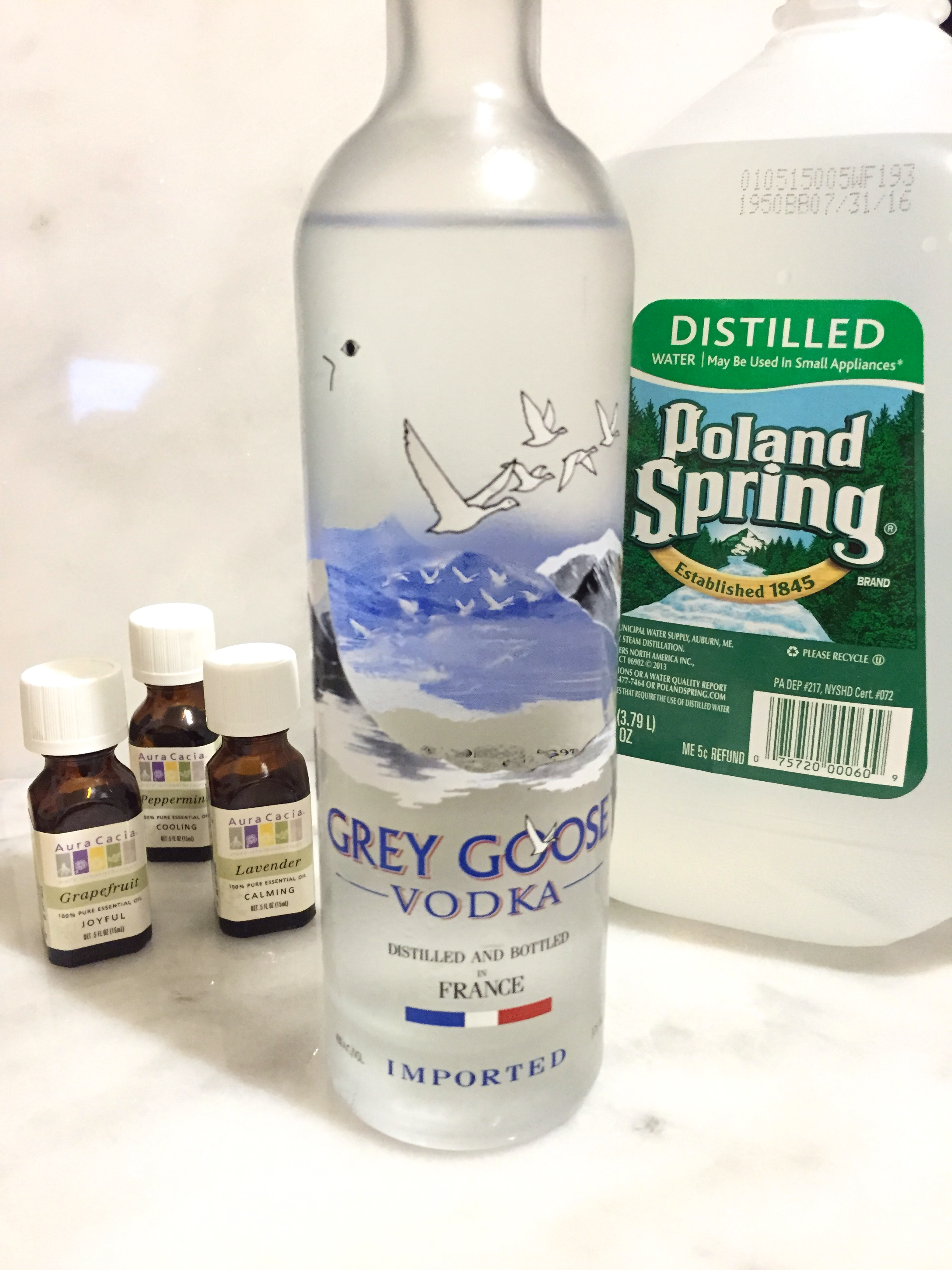 Vodka, water, and essential oils for a diy scent-masking spray