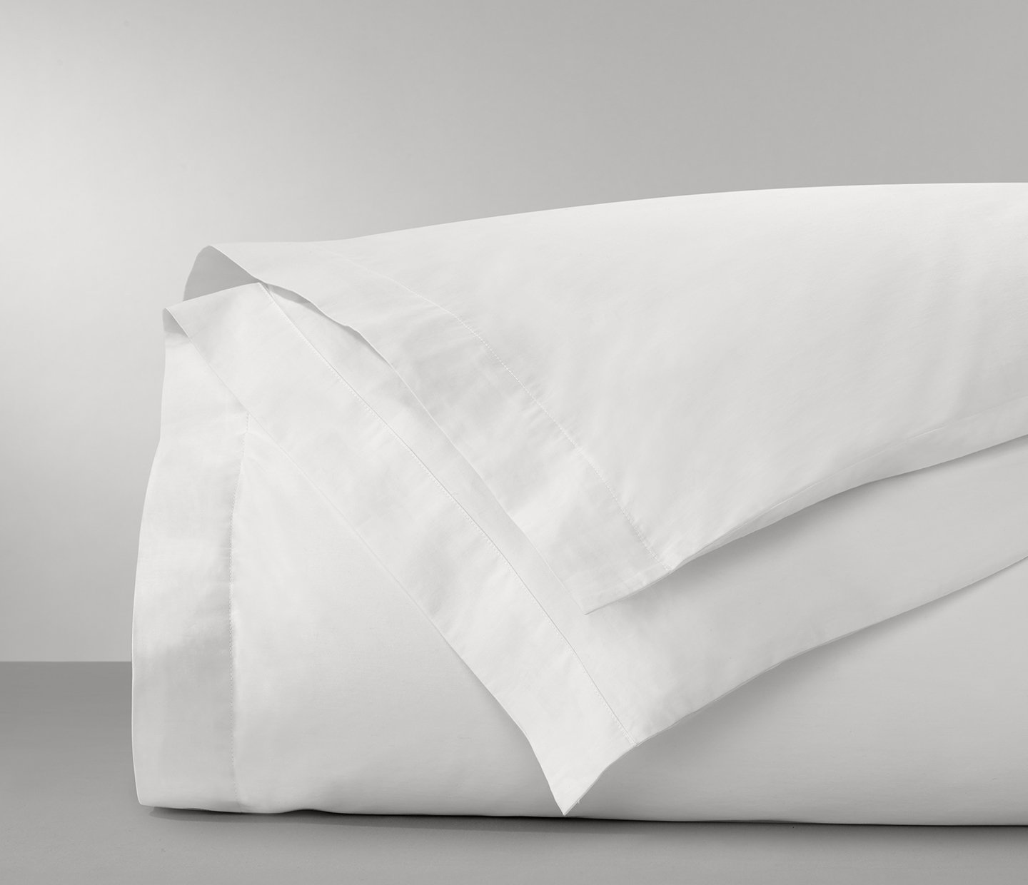 If you're on the hunt for a special, crisp white bedding collection or duvet cover made from 100% organic cotton look no more. We find a simple, classic white duvet cover is a great basic essential. Coordinate it with throw pillows and a cozy throw for a layered bed.  learn how to make a beautiful bed every single time here.